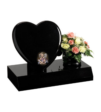 Black granite children's headstone with heart shaped memorial and rose bowl vase.