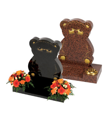 Black granite children's headstone with carved bear shape and etched bear features.