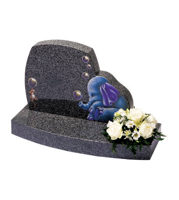 Impala grey granite children's headstone with gentle curves and children's toy designs.