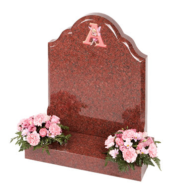 Ruby red granite children-s headstone with unique fairy-tale lettering.