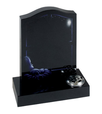 Black granite children's headstone with etched design of a child sleeping.