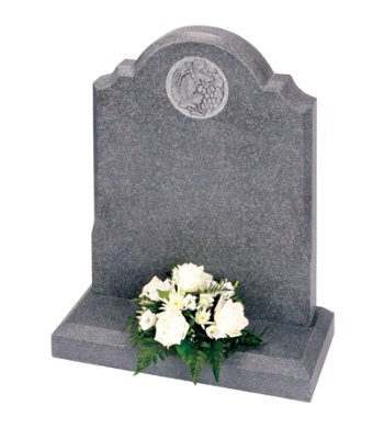 Honed dark grey granite memorial with a deep carved design.