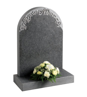 Honed south african dark grey granite headstone with decorative carved letters.