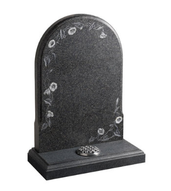 Honed south african dark grey granite memorial with carved flowers.