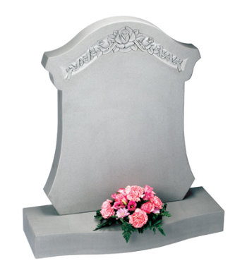 Serena stone headstone with deep floral carving on a unique shape.