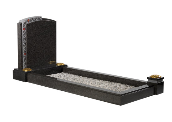 South African dark grey granite kerb memorial with intricately carved lattice work and contrasting material finishes.