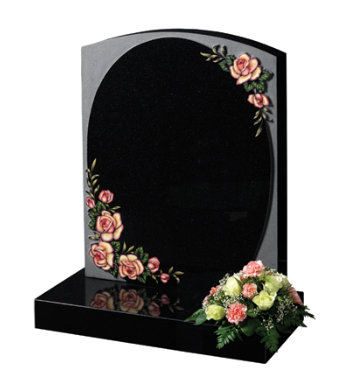 Black granite headstone of camber top shape with decorative carved roses.
