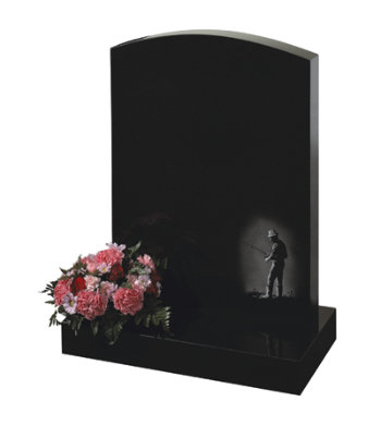 Black granite headstone of camber top shape with etching of fisherman.