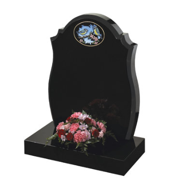 Black granite headstone with centre round, checked shoulders and barrel sides.