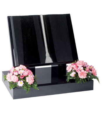 Black granite book shaped headstone with fully carved book and natural tassel.
