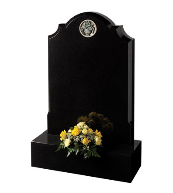 Black granite headstone with centre round checked shoulders and 6inch base.