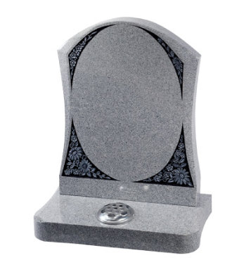 Sera grey granite headstone with carved floral panels.