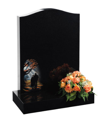 Black granite headstone with ogee top with decorative autumnal design.