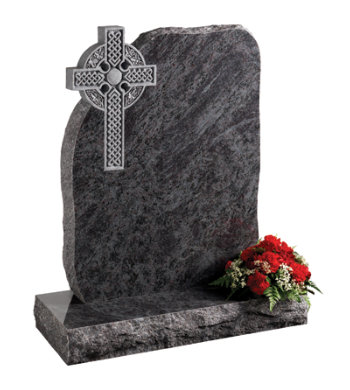 Lavender blue granite headstone of rustic shape with pitched edges and celtic cross carving.