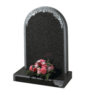Part polished South African dark grey granite with carved flowers to headstone and base.