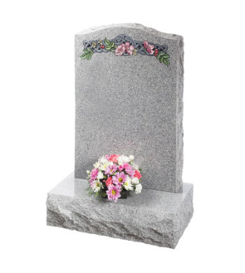 Indian grey granite headstone with pitched edges and carved celtic knot and flowers.