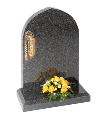 South African dark grey granite headstone with gothic top and chamfered base.