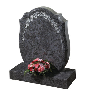 Lavender blue granite headstone with large bowed profile and floral carving.