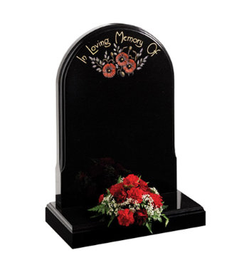 Black granite headstone of norman round shape and mouldings front and back.