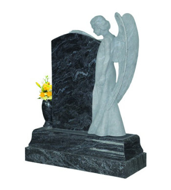 Lavender blue granite headstone with angel sculpture overlooking from the right.