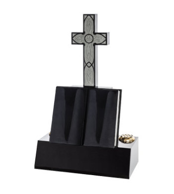 Black granite headstone with sculpted Latin cross and open book.