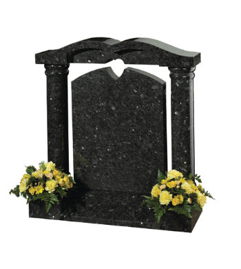 Emerald pearl granite headstone of pillared shape with heart detail.