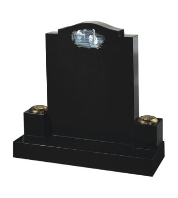 Black granite headstone with accompanying block vases.