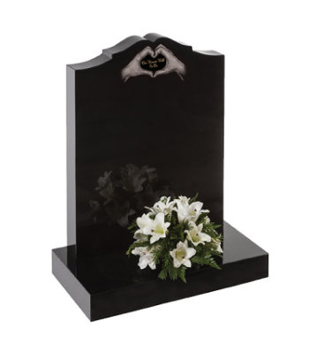 Black granite headstone of heart ogee shape with stepped shoulders.